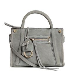 Gray. PREMIUM QUALITY. Suede shoulder bag with two handles and a narrow, detachable shoulder strap. One small outer compartment with zip and key ring