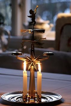 One of my all-time favorite Christmas decorations! The chiming and candlelight is so peaceful during stressful holidays. swedish candle holder/mobile. (the heat of the flame turns the mobile and makes it chime.)