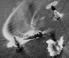 The Japanese cruiser IJN Nachi under attack by American carrier aircraft near the Phillipines. It would be sunk later in the day. Nov 1944. M