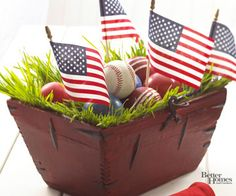 Baseball party centerpiece idea.  Instead of American flags you could use team pennant flags.