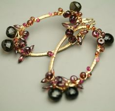 Reserved - Wire Wrapped Gemstone Earrings Red Garnet Smoky Quartz Gold Fill Oval Dangle Earring.  via Etsy. Created by fussjewelry. Belong in a fairytale.