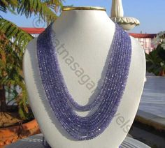 Natural Tanzanite Gemstone Beads possess property of spar transparent and are available in Exotic Purple Blue Color with micro cut, Rondelles Shape.