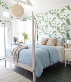 In this California home, the owner's inspired use of wallpaper augments the endless-summer fantasy, like this Cole & Sons design that evokes palm trees in the master bedroom.