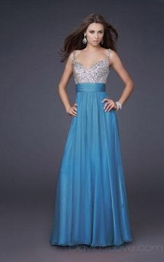 Maid of honor dress , but the same blue as the bridesmaid.