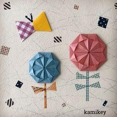 伝承作品の「勲章」両面色付きの和紙で作ったら、おはなのような、太陽のような。 #origami #折り紙 #kamikey