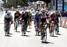 Nikias Arndt celebrating his narrow win to take out the Cadel Evans Great Ocean Road Race