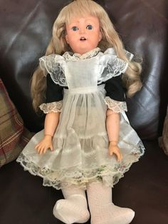 """Antique doll Heubach & Köppelsdorf 312 19"""" tall with bisque head and modern composition jointed body with needs tightening up, she has a real hair wig which is in good condition, blue sleep eyes which are a bit slow to work. 