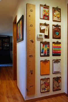 thrifted clipboards used to create a gallery wall for kids artwork, calendars…