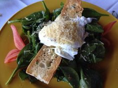 The Golden Truffle's (Costa Mesa) Spinach Salad topped with poached eggs and Parm. Honey-roasted shallots.