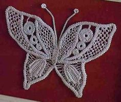crochet butterfly - i think, this is Romanian needle lace; there are a lot more crochet butterflies with charts