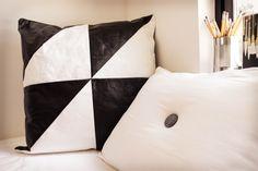 Black and white kraft-tex™ pillow by Sophia Caldwell