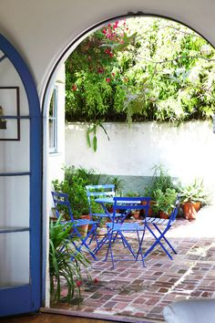 Small courtyard with arched door ~ photography by Laure Joliet