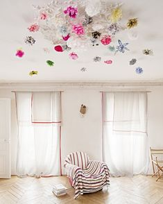 Ceiling enchantment—- some tissue paper or silk flowers tumbling from up above; could also go on a wall or vanity.
