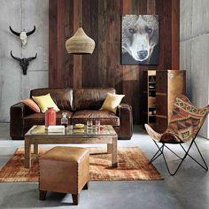 This living room give us major travel envy. #ShopNow -- Click link on @maisonsdumonde -- #Batik #bear #livingroom #sofa #chair #brown #carpet #lamp #vase #cushions #wood #mymdm #maisonsdumonde