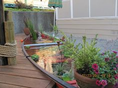 Add interest to your yardscape with a pond *inside* a canoe.