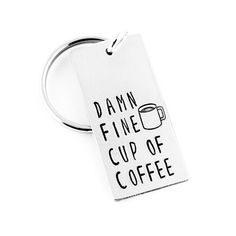 """Damn Fine Cup of Coffee Keychain - Accessories - Agent Dale Cooper - Coffee Lover Gift - Aluminum Key Chain. This """"Damn Fine Cup of Coffee"""" aluminum key chain is stamped by hand, one letter at a time and makes a great gift! A coffee cup design is stamped near the top of the keychain. This item is made with an aluminum blank that measures 3/4"""" x 1 1/2"""" in size, with a jump ring attaching a 1"""" split key ring. Please note that due to the nature of hand stamping, every item varies slightly…"""