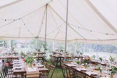 Indoor wedding dinner in a beautiful tent. Boho / vintage / botanical wedding