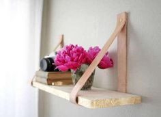 Leather Strap Shelving. Cool use of leather.  Time to ditch the boring brackets and opt for a simple but sleek look. With just a few strips of leather and a piece of wood, you can make your own shelf in a matter of hours. The best part, all those old leather belts at the bottom of your closet can finally be put to use.