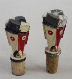 ein-bleistift-und-radiergummi:  Charles Loupot - Set of two polychrome metal Caps, geometrized representing the face of Nectar, symbol Nicolas.