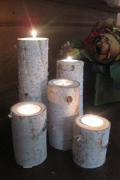 "Large Birch Bark Log Tea Light Candle Holders Set of 5: These birch candle holders measure 6"",5"",4"",3""and 2"". The diameter is approx. 2""-3"". I have also included the tea lights!"