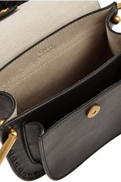 Black leather (Calf) Snap-fastening front flap Comes with dust bag Weighs approximately 2lbs/ 0.9kg Made in Italy