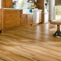 The luxury vinyl tile flooring chosen for this kitchen is absolutely beautiful. It has the look of hardwood, but the durability and easy care of vinyl! Luxury Vinyl Tile Flooring, Vinyl Plank Flooring, Luxury Vinyl Plank, Vinyl Planks, Wood Flooring, Living Room Flooring, Kitchen Flooring, Flooring Store, Kitchen Dining