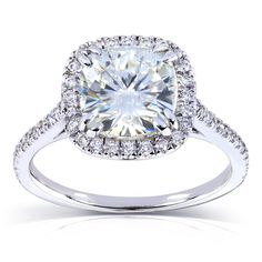 Crafted with brilliantly polished 14-karat white gold, this stunning engagement ring features a center-set cushion-cut moissanite, surrounded by a halo of genuine diamonds. The result is a simply elegant piece that will grace any woman's finger.