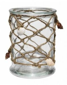 This hurricane candle holder featuring hemp netting and delicate shells will be a stunning addition to any coastal themed home. The shells ensure that it has that touch of coastal bliss while the hemp netting allows the slight feel of natural fibres.