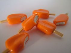 Orange and Cream Ice Cream Charm, Miniature Food Jewelry, Polymer Clay Food Charm. $6.00, via Etsy.