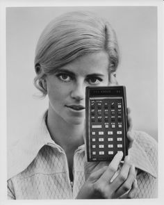 A girl holds up Hewlett-Packard's HP-35, the world's first scientific pocket calculator. For more information about klokers, please visit our website: http://www.klokers.com/