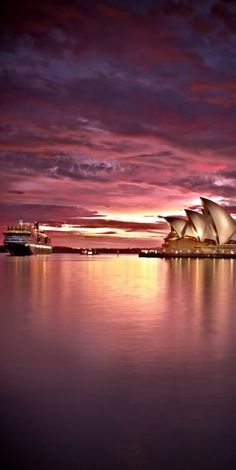 The QE2 passes the Opera House in Sydney, Australia • photo: Stanley Kozak on 500px