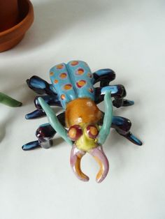 ceramic bugs research bugs create realistic version, hybrid version, and abstracted version to create a series