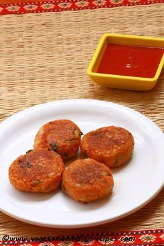 Aloo tikki / potato patties is a tasty Indian street food which is made with spiced and mashed potatoes.  These potatoes are then shaped into circles and shallow fried.  Potato patties can be served with tomato sauce or green chutney or with tamarind chutney.  Do try it out..  Click the link for recipe..  http://www.vegetarianindianrecipes.com/2015/07/aloo-tikki-recipe-how-to-make-aloo-tikki-potato-patties-recipe.html