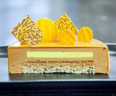 Entremet : Gianduja Mousse , Passion Fruit Cremeux, Hazelnut Streusel…