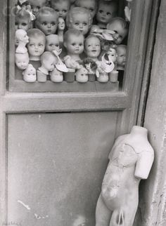 Vincenzo Balocchi - Dolls Heads and Torso in Window, 1951. S)