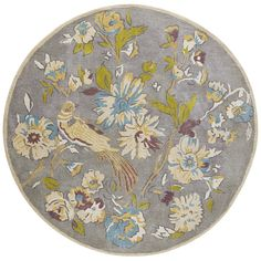 Inspired by nature, our round rug presents an enchanting scene. Flowers bloom and a bird perches amid a vibrant palette of turquoise, cream, crimson, goldenrod and olive green. Its 100% hand-tufted wool construction means comfort will flourish wherever you need it most.