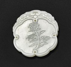 AN INSCRIBED WHITE JADE 'TAMPALA' PENDANT QING DYNASTY