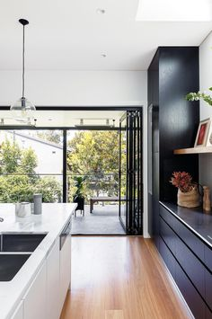 Bi-fold doors and generous skylight positioned just above the back zone of the kitchen.  Make this a bright area of the house.