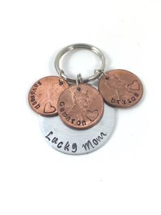A personal favorite from my Etsy shop https://www.etsy.com/listing/277859258/handstamped-lucky-mom-disc-pennies-with