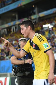 Colombia's midfielder James Rodriguez celebrates after scoring Colombia's fourth goal during the Group C football match between Japan and Colombia at the Pantanal Arena in Cuiaba during the 2014 FIFA World Cup on June 24, 2014.