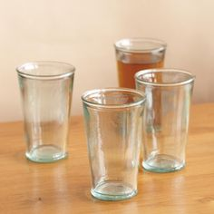 VALENCIA TUMBLERS, SET OF 4 -- Infused with warm Mediterranean sunlight, our completely recycled glass tumblers are ever-so-slightly teal-tinted and meticulously molded for the sort of rough-edged refinement that's perfect for spontaneous gatherings, patio parties and balmy brunches. Not microwave safe. Hand wash. Made in Spain. Exclusive. Set of 4, 8 oz.