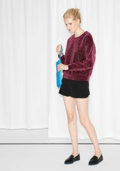 Made from a sparkling scuba fabric, this festive sweater features a contrasting clean-cut fit.