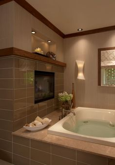 Fireplace by the tub...ooohhhh ahhh. Love the tile too.
