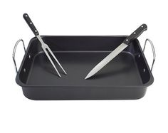 Roaster With Carving Tools £15.00 Carbon steel roasting tray with stainless steel handles. Nonstick interior. Includes carving knife and fork. Size L43 x W28 x H10cm