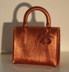 Lady Dior bag mummified in copper wire by London artist Alice Anderson.