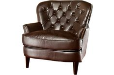 Bonded leather arm chair with tufted detaliing and nailhead trim. Product: Chair Construction Material: Hardwood and bonded leather Color: Brown and espresso Features: Button-tufted back Dimensions: H x W x D Note: Assembly required The Loft, Leather Club Chairs, Leather Lounge, Tufting Buttons, Chair And Ottoman, Chair Cushions, Chair Pads, My Living Room, Living Spaces