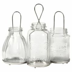 """Set of 3 glass jar lanterns.  Product: Small, medium, and large lanternConstruction Material: Glass and ironColor: Clear and silverDimensions: Small: 4.25"""" H x 4.5"""" DiameterMedium: 6"""" H x 4.5"""" DiameterLarge: 7.5"""" H x 4.5"""" Diameter"""