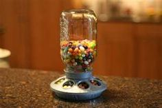 Turn a bird feeder into a candy dispenser! And of course it is done with a Mason Jar!