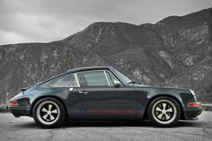 Enjoy all the looks and vintage appeal of a classic 911 and the modern ride you'd expect from a new set of wheels with the Singer Porsche 911 Indonesia. This rebuilt beauty features a dark grey exterior with Porsche branding...