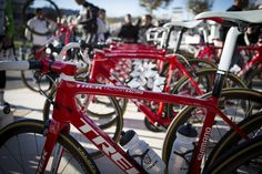 Trek Factory Racing show off new bikes for the 2015 season which have adopted a striking red colour scheme over last year's black.